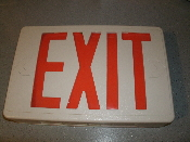 Exit Sign. Electric. New. Ivory. Must be wired. Comes with mounting bracket but no screws. 120V AC. 0.18A.