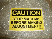 "CAUTION Stop Machine Before Making Adjustments Vinyl Sticker Sign. New. 3 1/2"" H X 5"" W. Yellow and Black Lettering."