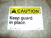 "CAUTION Keep Guard in Place Sign. New. Vinyl Sticker. 3 1/2"" H X 5"" W. Yellow and White with Black Letters."