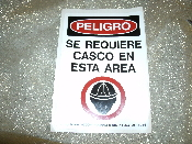 "Peligro Se Requiere Casco En Esta Area Sign. Spanish. New. OSHA Danger Hard Hat Area. Vinyl Laminated Sticker. 3 1/2"" W X 5"" H. Stick them near controls or in other high visibility areas."