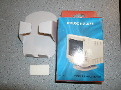 New in retail package. Model: HT-592. Ivory color. Mouse holder. Attaches to your monitor. Fits any normal size mouse.