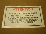 "ATTENTION If Belt Stops Please Retract Unit And Follow Instructions Posted By The Power Panel Controls. Vinyl Sticker. New. 7 1/4"" W X 4"" H."