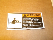 "Warning Equipment can start automatically during servicing. Exposed moving parts can cause severe injury. Follow service manual instructions. New. Laminated vinyl sign. 5"" W X 2 1/2"" H."