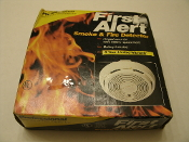 First Alert 83R Professional Smoke and Fire Detector. Hinged cover. UPC: 030699206810.