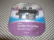 Radio Shack Satellite TV Splitter. 16-2570. Four Way Splitter. New. 75 Ohms. Frequency Range: 40-2150MHz. 160-2570. 040293011796. Splits satellite signal