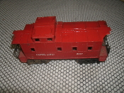 Lionel Lines 6047 Cabosse. Used. Red. 8 Wheels. 2 Pieces of the Roof Corners Are Broken.