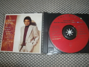 Johnny Mathis. How Do You Keep The Music Playing? 074645320427. The Songs of Michel Legrand and Alan & Mariln Bergman. Used. CK 53201. CK 53204.