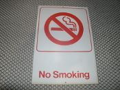 "No Smoking Plastic Sign with 2 Screw Holes. 6"" X 9"". White with Red Lettering and No Smoking Symbol. New. No screws are included. Quanity discounts are available on this product."