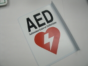2-Way View AED Sign - Automated External Defibrillator. 81750. L Shaped Plastic sign has 2 Screw holes